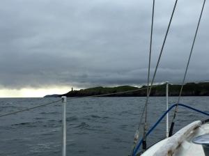 Rain on horizon off boat