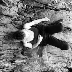 woman lying on rocks