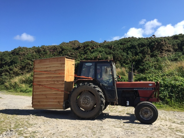 The compost toilet for the flower garden being transported to site.